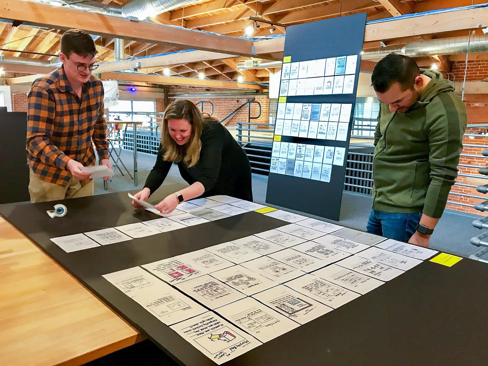 UX consultants prepare concept cards for an upcoming workshop on the mezzanine level of our San Diego design studio.