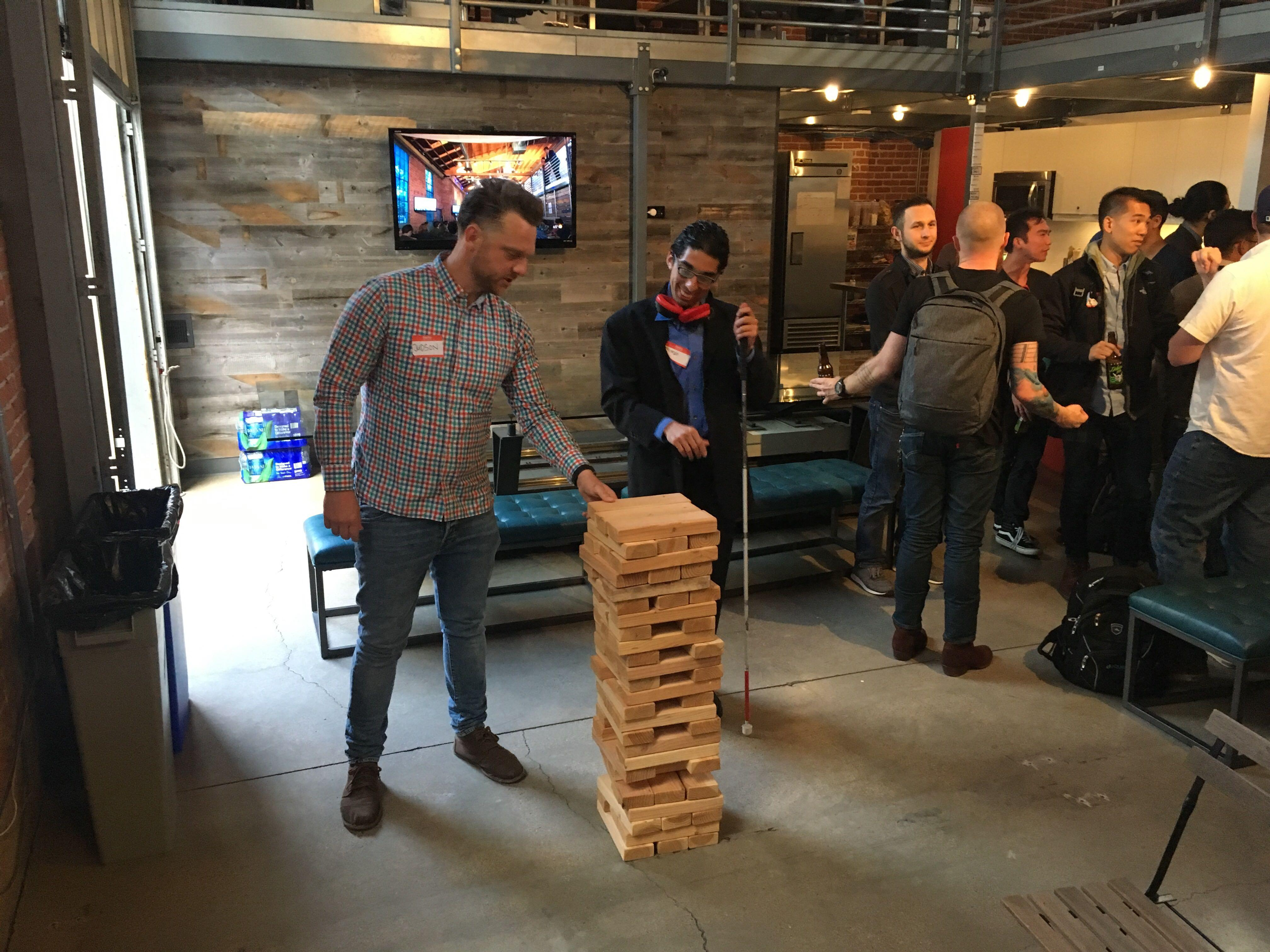 Attendees mix, mingle, and play giant Jenga in our studio.