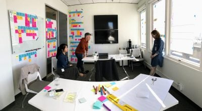 Designers at Blink collaborating on an experience map