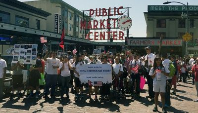 A crowd in front of Pike Place Public Market